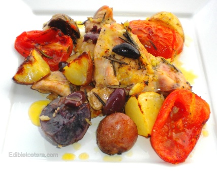 Chicken roasted with potatoes, olives, tomatoes, rosemary & lemon