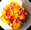 Oranges in a Cranberry Caramel Sauce with Candied Cranberries